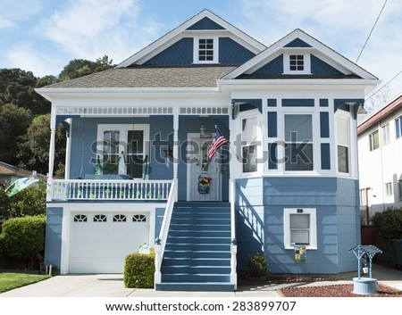 Nice old blue and white house with american flag in California