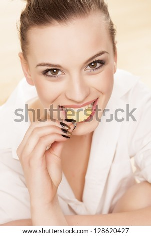 nice pretty girl smiling and posing with chips in her mouth