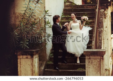 nice sweet happy bride and groom holding hand on the old stairs in Rome Italy