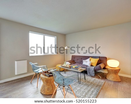 Nicely furnished living room interior after remodeling with wicker details in decor, modern glass chairs. Northwest, USA