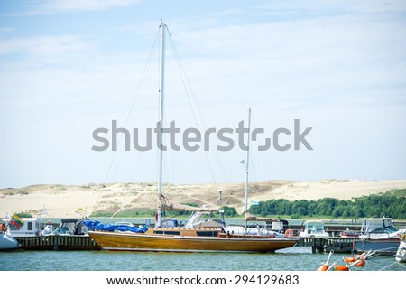 NIDA - JULY 14: Luxury wooden yacht in Nida Harbour, Curonian Lagoon on July 14, 2014 Nida, Klaipeda, Lithuania. The Port of Nida is located on the Curonian Lagoon side of the Curonian Spit.