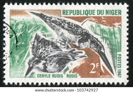 NIGER - CIRCA 1967: stamp printed by Niger shows Pied kingfisher, circa 1967