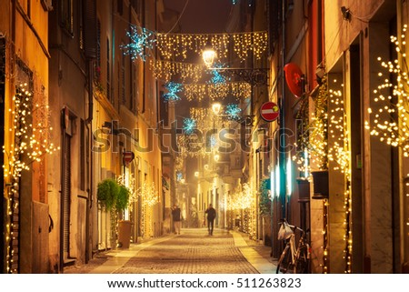 Night old street with Christmas decoration in Parma, Emilia-Romagna, Italy.