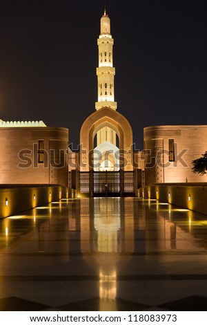 Night shot of the Sultan Qaboos Grand Mosque in Muscat, Oman.