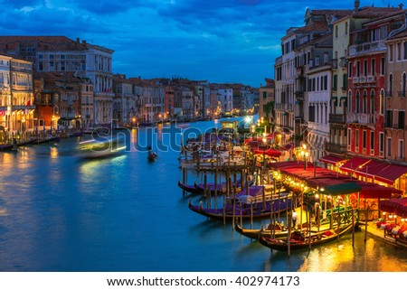 Night view of Grand Canal with gondolas in Venice. Italy
