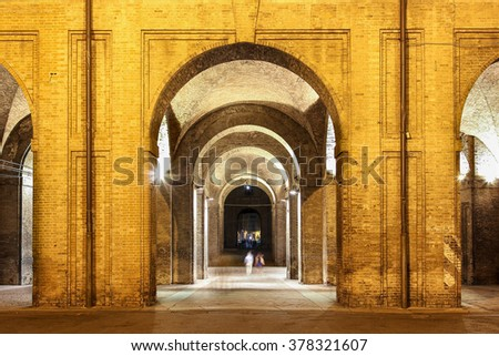 Night view of the arches of historic Pilotta palace in Parma, Italy.