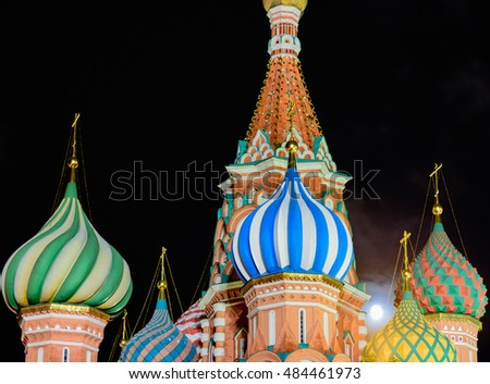 Night view of the Saint Basil's cathedral in Moscow with moon through its dome