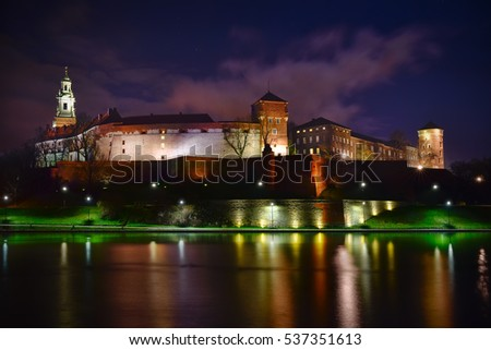 Night view of Wawel castle located at Vistula river in Cracow. Poland