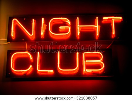 Nightclub neon sign hanging on the wall