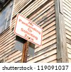 no panhandling or soliciting zone sign near wooden building - stock photo