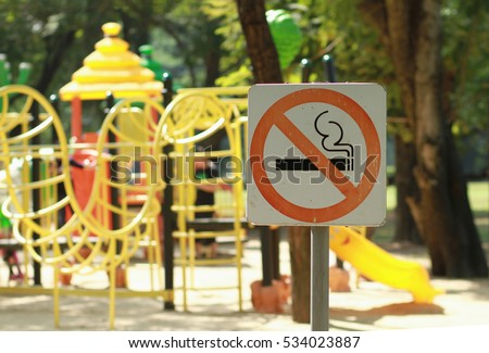 No smoking sign near children's playground in public park