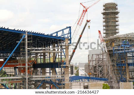NONTHABURI - August 30: Construction workers at work on the office building on August 30, 2014 in Nonthaburi, Thailand. The workers were building the offices for replacement the old offices.