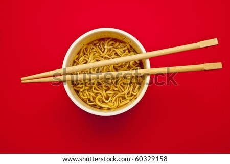 Noodles Cup and chopsticks on a red background
