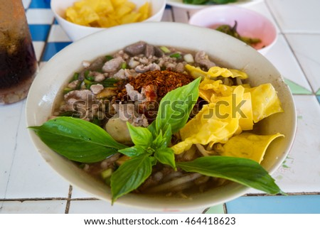 noodles with boiled pork  on a bowl