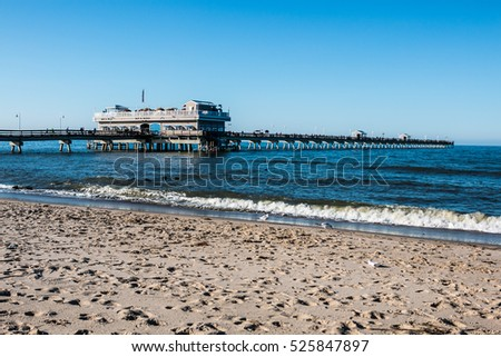 NORFOLK, VIRGINIA - MAY 2, 2015:  People enjoying a spring day on the Ocean View beach and fishing pier.