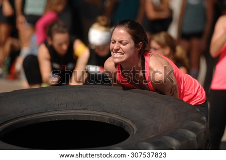 NORTH VANCOUVER, CANADA - SEPTEMBER 6, 2014: Female athletes show their strength during the FemSport Women's All Strength & Fitness promotional event on Sep.6, 2014 in North Vancouver, Canada.