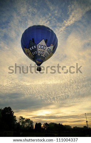 NORTHAMPTON, ENGLAND - AUGUST 18: Hot Air Balloon sunrise launching at the Northampton Balloon Festival, on August 18, 2012 in Northampton, England.