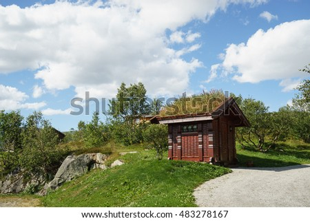 Norwegian traditional wooden house with grasses on the roof near Voringsfossen, Eidfjord, Norway