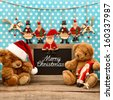 nostalgic home christmas decoration with antique toys. vintage arrangement  and blackboard with sample text Merry Christmas - stock photo