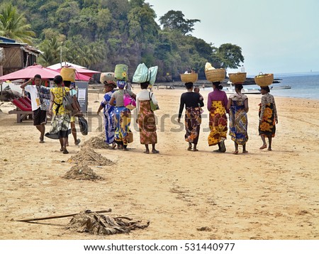 NOSY BE , MADAGASCAR, NOVEMBER 2.2016,  indigenous women in traditional clothes hampers with their heads, Nosy Be, Madagascar,  November 2. 2016