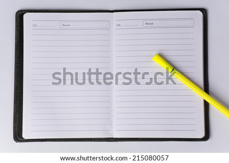 Note book and yellow pen