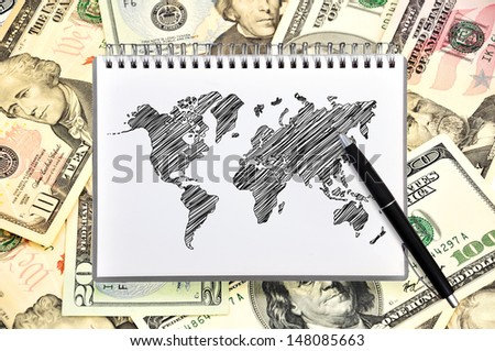 note book with map on background of dollars