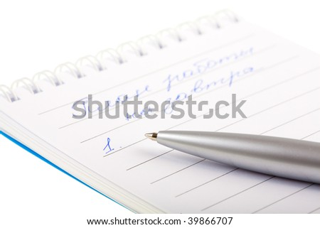 Notebook and ball pen on the white background, isolated.