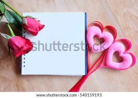 Notebook with roses on wooden background,in valentine,s day