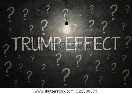 November 17, 2016: Image of a bright light bulb with question marks and text of Trump Effect on the chalkboard