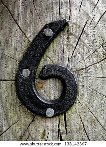 number six in iron on wood, vintage rustic grunge look