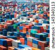 numerous shipping containers in port - stock photo