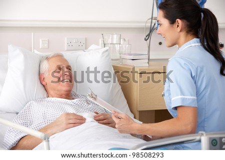 Nurse with Patient in Bed