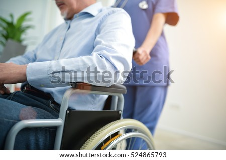 Nurse pushing a wheelchair
