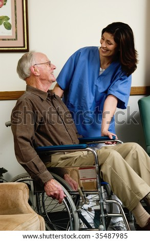 nurse with man in wheelchair