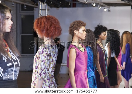 "NY, NY - FEB 07, 2014: Models pose on ""Zero Squared""  Fall/ Winter 2014 Presentation by Tabii Just during Mercedes-Benz Fashion Week at Launch NYC presented by Manufacture New York."