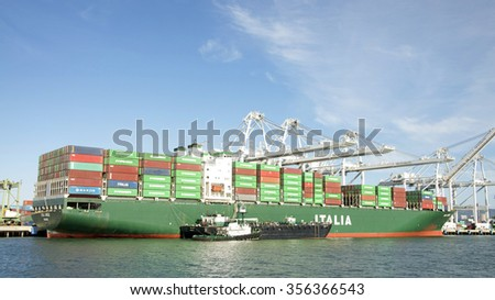OAKLAND, CA - DECEMBER 23, 2015: Italia Cargo Ship ITAL UNICA loading at the Port of Oakland.
