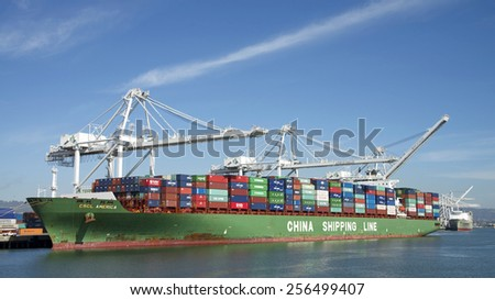 OAKLAND, CA - FEBRUARY 26, 2015: CSCL Cargo Ship AMERICA docked at the Port of Oakland. The Port of Oakland's cargo volume makes it the fifth busiest container port in the United States.