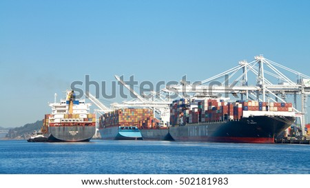 Oakland, CA - September 26, 2016: Cargo Ship NIKOLAS entering the Port of Oakland, the fifth busiest port in the United States.