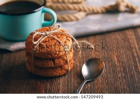 oatmeal cookies on a wooden background with coffee
