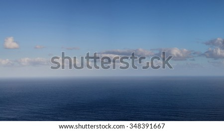 ocean horizon with blue sky and clouds -panorama