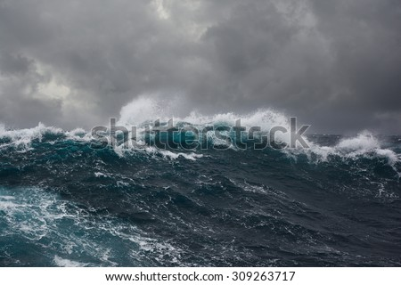 Dark Clouds Crashing Ocean Waves During Stock Photo - Beautiful photographs of storm clouds look like rolling ocean waves