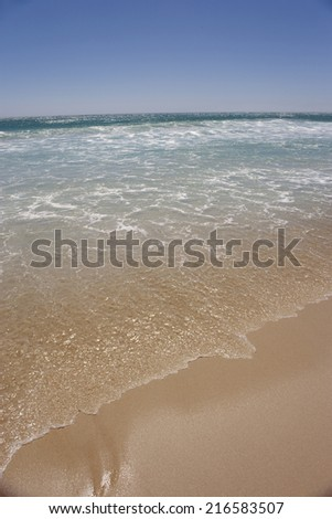 Ocean waves flowing on beach