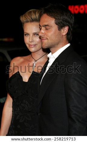 "October 10, 2005 - Hollywood - Charlize Theron and Stuart Townsend at the ""North Country"" Los Angeles Premiere at the Grauman's Chinese Theatre Los Angeles, California United States."