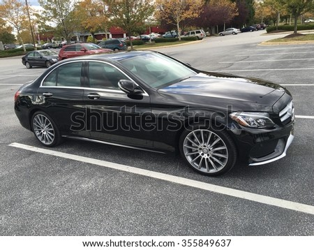 ODENTON, MD, USA - OCTOBER 18, 2015: A Mercedes Benz C-400. Mercedes Benz is a luxury car manufacturer and dealer.