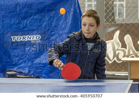 ODESSA, UKRAINE - April 9, 2016: Athletes amateurs playing table tennis in the open air during the beginning of the sporting event of the summer sports season