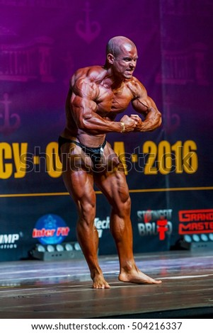 ODESSA, UKRAINE -23 October 2016: Athletes men participate in Championship of Ukraine on bodybuilding. category fitness and bodybuilding model. Beautiful athletic figure with big muscle men on stage