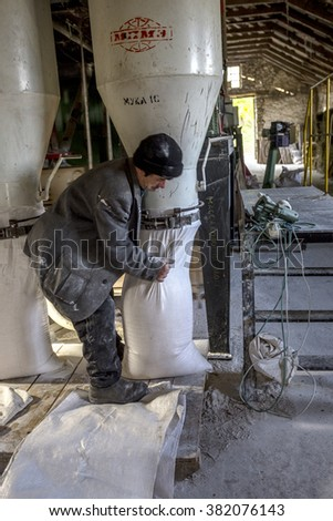 Odessa, Ukraine - 10 October, 2014: The technological process of production of grinding wheat on a small farm automatic modern mills. Private sector of agriculture. Farm closed loops