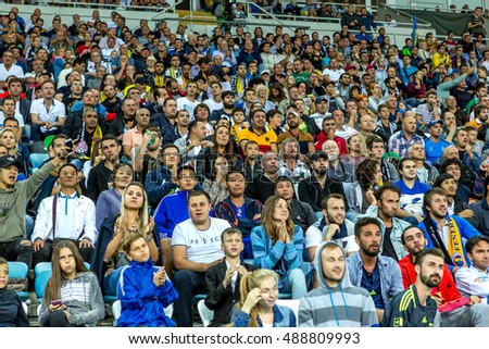ODESSA, UKRAINE - September 15,2016: Active fans FENERBAHCE Istanbul and Zarya Luhansk. stands with attributes during match of Championship European Football League. Emotions stands of sports audience