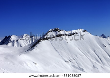 Off-piste slope in sun day and traces of avalanches. Caucasus Mountains, Georgia. Ski resort Gudauri.