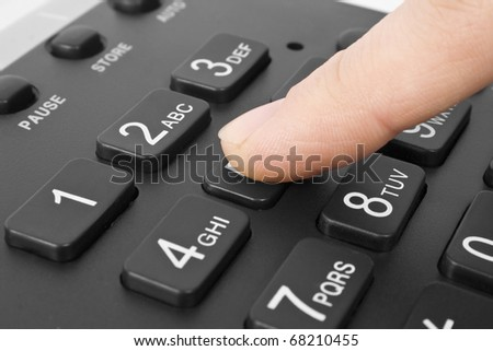 office black telephone with hand isolated on white